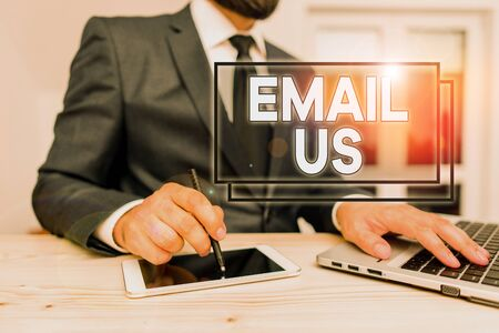 Writing note showing Email Us. Business concept for Sending a commercial message to a group of showing using mail Male human wear formal clothes present use hitech smartphone