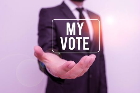 Writing note showing My Vote. Business concept for the act of showing your choice or opinion in an election or meeting Male human with beard wear formal working suit clothes hand