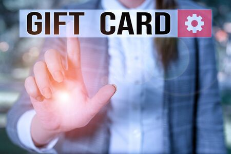 Text sign showing Gift Card. Business photo showcasing A present usually made of paper that contains your message Business woman in the nature pointing with the finger into empty space