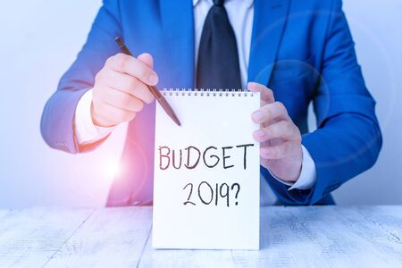 Handwriting text Budget 2019 Question. Conceptual photo estimate of income and expenditure for next year Man holds empty paper with copy space in front of him Copy Space 版權商用圖片