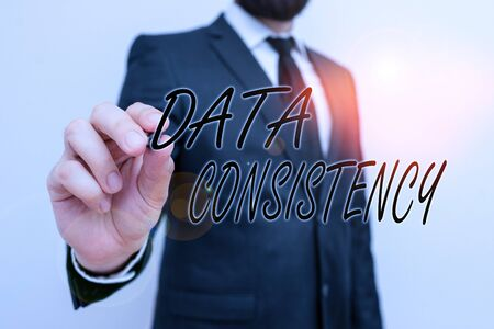 Writing note showing Data Consistency. Business concept for data values are the same for all instances of application Male human with beard wear formal working suit clothes hand 版權商用圖片