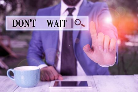 Conceptual hand writing showing Don T Wait. Concept meaning Take action now and do something for a purpose Act quickly Businessman with pointing finger in front of him Stock Photo - 134502850
