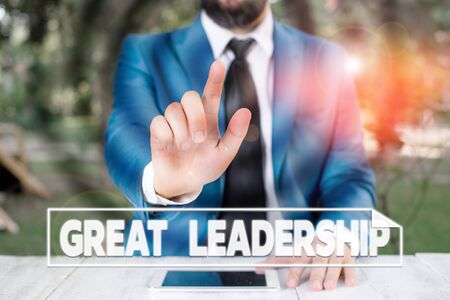 Writing note showing Great Leadership. Business concept for motivating showing to act towards achieving a common goal Businessman with pointing finger in front of him