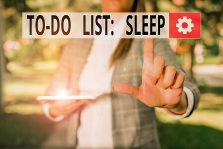 Writing note showing To Do List Sleep. Business concept for Things to be done Priority object is to take a rest Outdoor scene with business woman holds lap top with touch screen 版權商用圖片