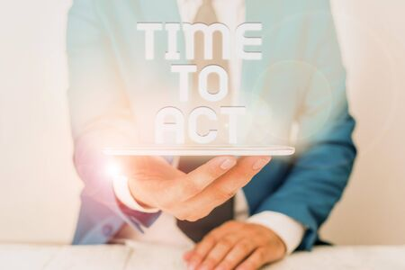 Text sign showing Time To Act. Business photo text Do it now Response Immediately Something need to be done Businessman in blue suite with a tie holds lap top in hands Stock Photo