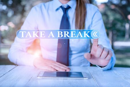 Handwriting text Take A Break. Conceptual photo Resting Stop doing something recreation time get out of work Female business person sitting by table and holding mobile phone