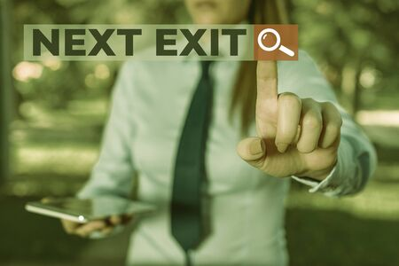 Word writing text Next Exit. Business photo showcasing the following way out or act of leaving in a place or highway Handsome business girl pointing with finger into empty space