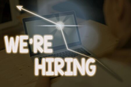 Writing note showing We Re Hiring. Business concept for recently you employ someone or pay someone to do particular job