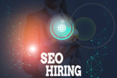 Writing note showing Seo Hiring. Business concept for employing a specialist will develop content to include keywords