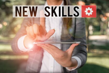 Text sign showing New Skills. Business photo text Recently Acquired Learned Abilities Knowledge Competences Outdoor scene with business woman holds lap top with touch screen