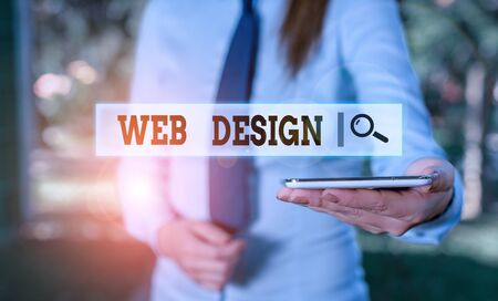 Writing note showing Web Design. Business concept for Website development Designing and process of creating websites Business woman in shirt holding laptop and mobile phone Stock Photo