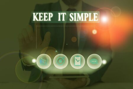 Conceptual hand writing showing Keep It Simple. Concept meaning Remain in the simple place or position not complicated