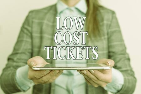 Handwriting text writing Low Cost Tickets. Conceptual photo small paper bought to provide access to service or show Business concept with mobile phone and business woman