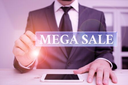 Conceptual hand writing showing Mega Sale. Concept meaning The day full of special shopping deals and heavy discounts Male human wear formal clothes present use hitech smartphone Stock fotó