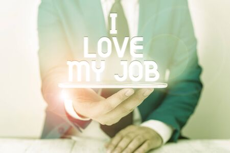 Text sign showing I Love My Job. Business photo text Enjoying the daily tasked assigned Contented on the occupation Businessman in blue suite with a tie holds lap top in hands Stock fotó