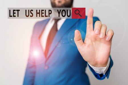 Text sign showing Let Us Help You. Business photo text Offering a service to someone to help him in his necessity Businessman with pointing finger in front of him