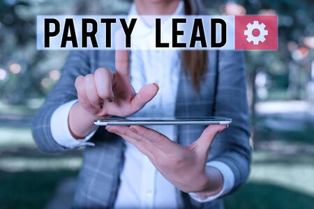 Text sign showing Party Lead. Business photo text acts as the official representative of their political party Outdoor scene with business woman holds lap top with touch screen