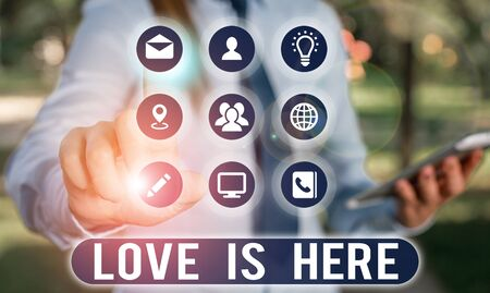 Text sign showing Love Is Here. Business photo showcasing Roanalysistic feeling Lovely emotion Positive Expression Care Joy