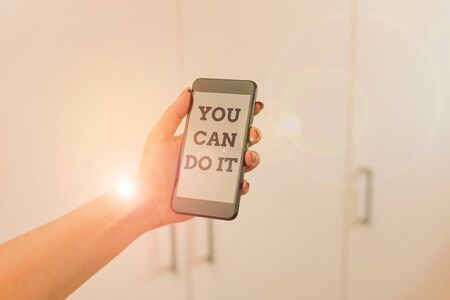 Writing note showing You Can Do It. Business concept for Bring it On Believing to oneself Give a try Take the chance woman using smartphone and technological devices inside the home