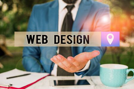 Writing note showing Web Design. Business concept for Website development Designing and process of creating websites Man in front of table. Mobile phone and notes on the table