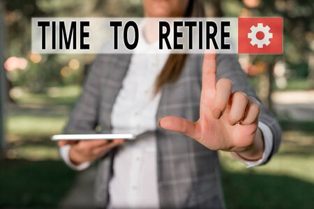 Writing note showing Time To Retire. Business concept for Take the pensioner status stop working in elderly old enough Outdoor scene with business woman holds lap top with touch screen Stock Photo