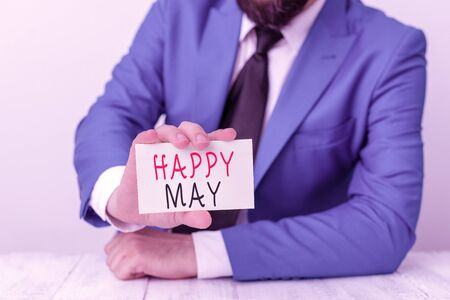 Word writing text Happy May. Business photo showcasing Happy new month Best wishes Fresh Start Celebrating Holiday Man holds empty paper with copy space in front of him Space