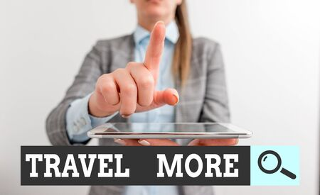 Writing note showing Travel More. Business concept for To make a journey often especially on long distance trip Digital business concept with business woman