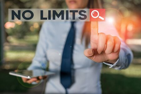 Word writing text No Limits. Business photo showcasing to do whatever you could with out restrictions and holding back Handsome business girl pointing with finger into empty space