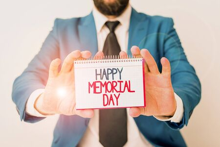 Word writing text Happy Memorial Day. Business photo showcasing Honoring Remembering those who died in military service Man holds empty paper with copy space in front of him Copy Space