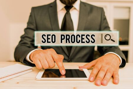 Conceptual hand writing showing Seo Process. Concept meaning steps of increasing the quality and quantity of website traffic Male human wear formal clothes present use hitech smartphone Stok Fotoğraf