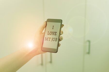 Writing note showing I Love My Job. Business concept for Enjoying the daily tasked assigned Contented on the occupation woman using smartphone and technological devices inside the home