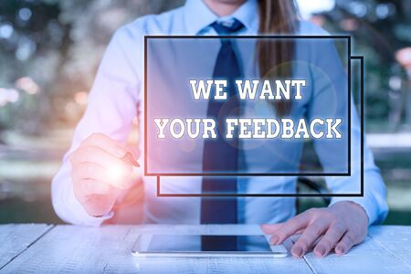 Text sign showing We Want Your Feedback. Business photo showcasing to Improve Perforanalysisce or Product Timely Reaction Female business person sitting by table and holding mobile phone