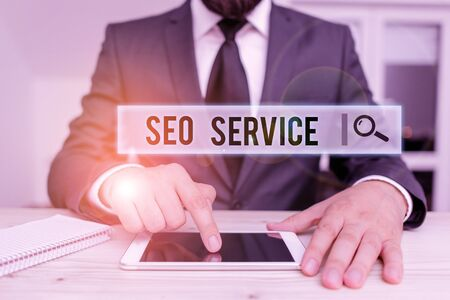 Conceptual hand writing showing Seo Service. Concept meaning suite of techniques and procedures to surge website visibility Male human wear formal clothes present use hitech smartphone