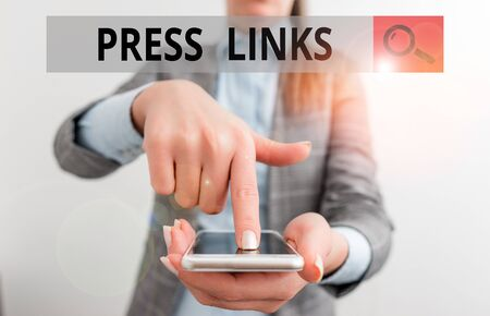 Writing note showing Press Links. Business concept for intended to analysisipulate a site s is ranking in Google search Business woman points with finger on touch screen Stock Photo