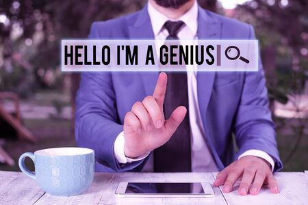 Handwriting text writing Hello I M A Genius. Conceptual photo Introduce yourself as over average demonstrating to others Businessman with pointing finger in front of him Stock fotó