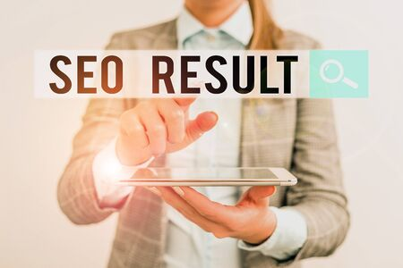Word writing text Seo Result. Business photo showcasing the list created by search engines in response to a query Business concept with mobile phone and business woman