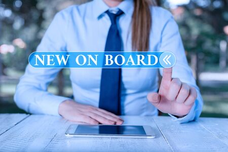 Handwriting text New On Board. Conceptual photo Welcome to the team Adaptation Collaboration Someone hired Female business person sitting by table and holding mobile phone Фото со стока