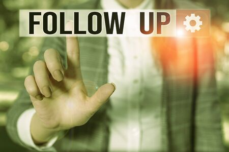 Text sign showing Follow Up. Business photo showcasing Additional info or any activity that needs to check secondly Business woman in the nature pointing with the finger into empty space
