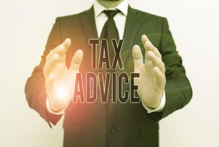Writing note showing Tax Advice. Business concept for tax agent service with advanced training and knowledge of tax law Male human with beard wear formal working suit clothes hand