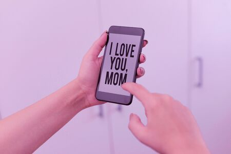 Word writing text I Love You Mom. Business photo showcasing Loving message emotional feelings affection warm declaration woman using smartphone office supplies technological devices inside home
