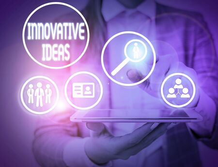 Writing note showing Innovative Ideas. Business concept for application of better solutions that meet new requirements Фото со стока