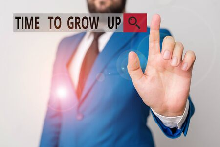 Text sign showing Time To Grow Up. Business photo text knowing that you are mature demonstrating have responsibility Businessman with pointing finger in front of him
