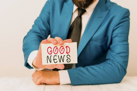 Word writing text Good News. Business photo showcasing Someone or something positive Encouraging uplifting or desirable Man holds empty paper with copy space in front of him Space