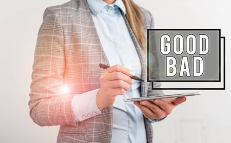 Word writing text Good Bad. Business photo showcasing to seem to be going to have a good or bad result Life choices Business woman pointing in empty space with pen