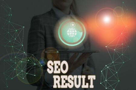 Writing note showing Seo Result. Business concept for the list created by search engines in response to a query Stock Photo