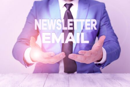 Conceptual hand writing showing Newsletter Email. Concept meaning email sent to subscribers informing them about the news Man holds empty paper with copy space in front of him Space