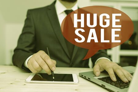Word writing text Huge Sale. Business photo showcasing putting products on high discount Great price Black Friday Male human wear formal clothes present presentation use hi tech smartphone