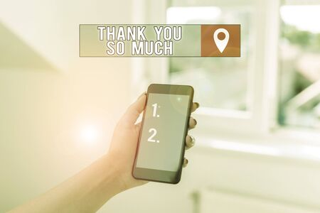 Text sign showing Thank You So Much. Business photo showcasing Expression of Gratitude Greetings of Appreciation woman using smartphone office supplies technological devices inside home