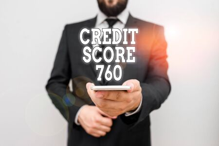 Text sign showing Credit Score 760. Business photo showcasing numerical expression based on level analysis of demonstrating Male human wear formal work suit hold smart hi tech smartphone use one hand