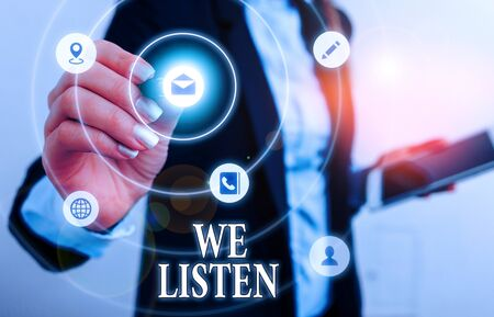 Text sign showing We Listen. Business photo showcasing Group of showing that is willing to hear anything you want to say
